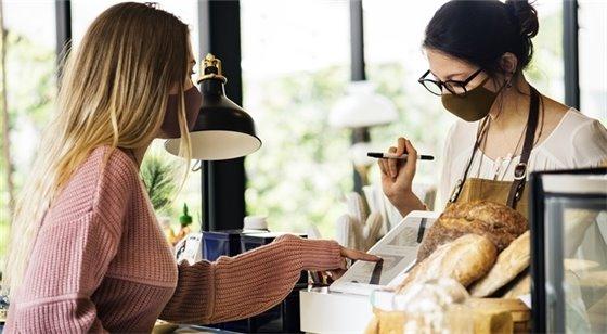 Women wearing masks in retail location
