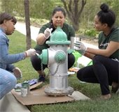 Love Brea volunteers painting fire hydrant