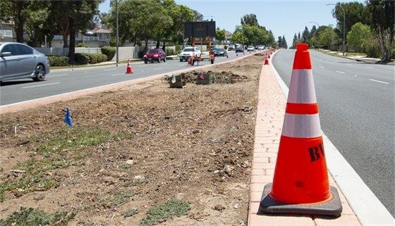 Construction cone on street median