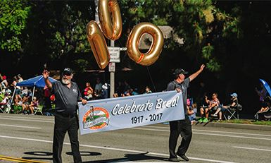 Photo of the lead Centennial Banner in the Centennial Parade